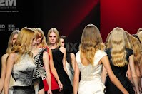 a group of models at the end of the the catwalk after the show at cibeles madrid fashion week