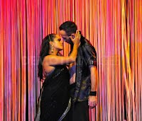 mistri in her role of the girl in love kissing her lover in the bollywood play dreams of bollywood in madrid